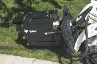 Side profile of Bobcat vibratory plow attachment.