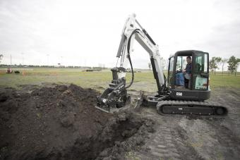 Bobcat plate compactor attachment is used with a compact excavator to compact dirt in a trench.