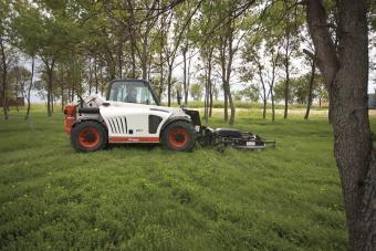 Side profile of V417 VersaHANDLER telescopic tool carrier with Bobcat mower attachment.