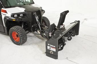 Studio shot of Bobcat utility vehicle snowblower attachment.