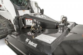 Dual offset motors on the Bobcat Brushcat rotary cutter attachment.
