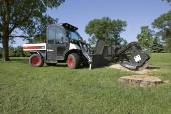 5600 Toolcat utility work machine with the stump grinder attachment grinds multiple tree stumps.