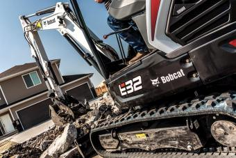 Bobcat R-Series E32 compact (mini) excavator with clamp attachment.