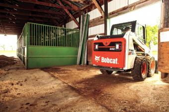 Bobcat S450 Skid-Steer Loader lead a barn