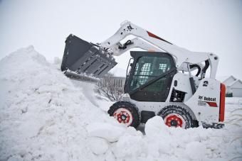 Bobcat S570 Skid-Steer Loader hauling snow