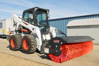 Bobcat T770 compact track loader sweeps a construction site with an angle broom attachment.