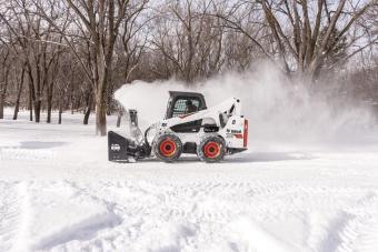 Bobcat S740 Skid-Steer Loader blowing snow