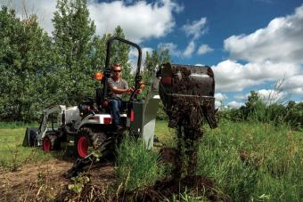 Acreage Owner Digging On Rural Property Using Bobcat CT1021 Sub-Compact Tractor With Backhoe Attachment