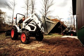 Acreage Owner Moving And Leveling Dirt Using Bobcat CT2035 Compact Tractor With Front-End Loader And Box Blade Implement
