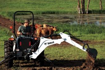 Rancher Digging Trench Using Backhoe Attachment On Bobcat CT4045 Compact Tractor
