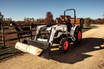 Ranch Owner Hauling Horse Feed In Front-End Loader Attachment On CT4058 Compact Tractor