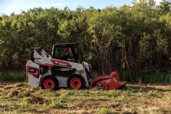 Landscaper Uses Bobcat S66 Skid-Steer Loader With Flail Cutter Attachment To Clear Undergrowth and Brush