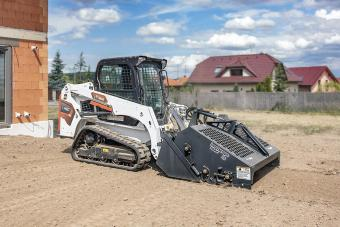 Bobcat T450 Compact Track Loader Preparing Residential Construction Site With Landscape Rake""
