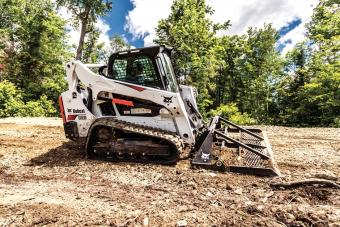 S650 skid-steer loader levels ground with the Bobcat landplane attachment.