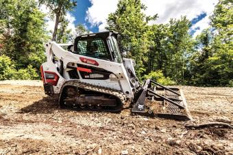 Landscaper Using A Bobcat T595 Compact Track Loader With Landplane Attachment To Level Ground